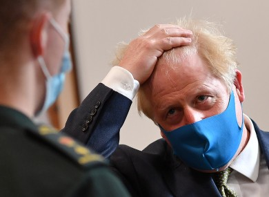 British Prime Minister Boris Johnson wearing a face covering yesterday.