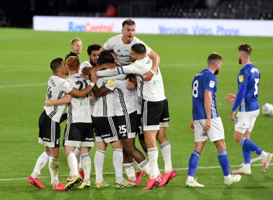 Fulham's Josh Onomah is mobbed by team-mates after scoring his side's second goal against Cardiff City.