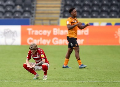 Contrasting emotions: Middlesbrough's Hayden Coulson dejected as match winner Hull City's Mallik Wilks celebrates after the match.