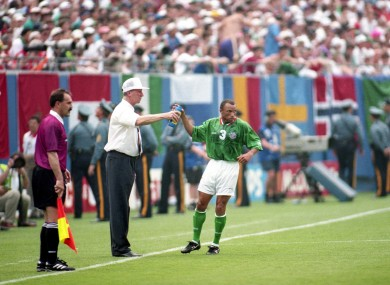 Ireland manager Jack Charlton gives water to Terry Phelan during the 1994 World Cup in the match against Italy.
