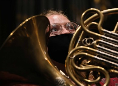 French horn player Hannah Miller is pictured rehearsing ahead of tonight's concert.