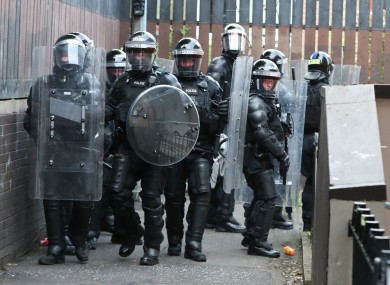 Police Service of Northern Ireland officers in riot gear carry out searches in the New Lodge area of Belfast yesterday.