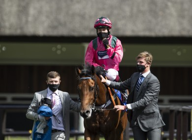 Jockey Cieren Fallon and Oxted return after winning the Darley July Cup Stakes on day three of The Moet and Chandon July Festival at Newmarket Racecourse.