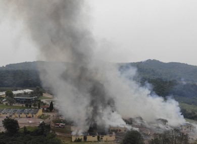 Smoke billows from a fire following an explosion at a fireworks factory outside the town of Hendek, Sakarya province, today.