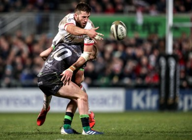 Stuart McCloskey is tackled by Conor Fitzgerald in December.