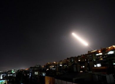 Syrian air defense missiles in the sky over Damascus.