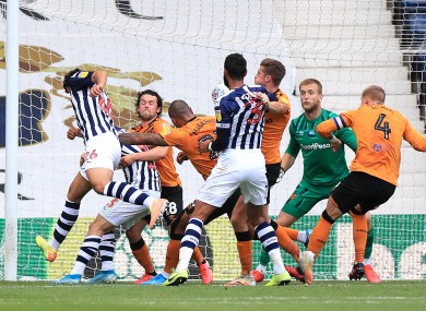 West Brom's Ahmed Hegazi scores his team's second goal against Hull.