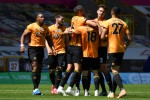 Wolverhampton Wanderers' Diogo Jota (centre) celebrates scoring.