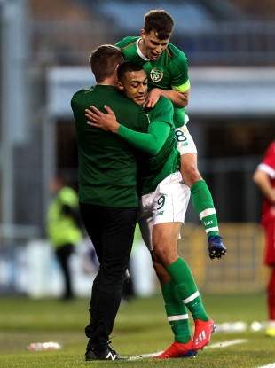 Adam Idah and Jayson Molumby embrace Stephen Kenny after Idah's goal against Luxembourg in an U21s Euro qualifier last year.