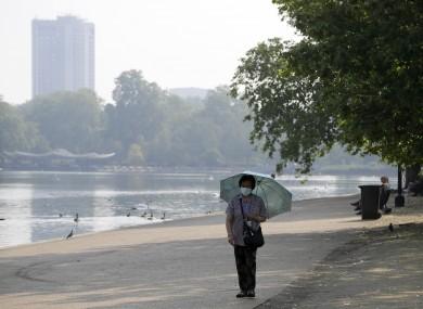 Woman wearing a mask in London's Hyde Park.