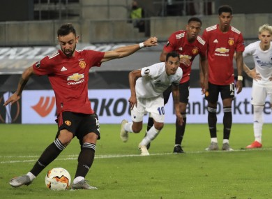 Manchester United's Bruno Fernandes scores from a penalty kick.