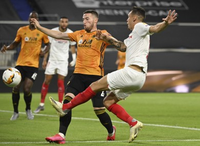 Matt Doherty battles with the goalscorer, Lucas Ocampos.