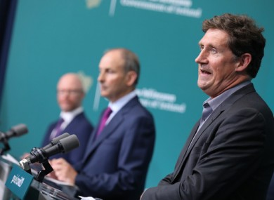 Transport Minister Eamon Ryan in the foreground in front the Taoiseach and Health Minister.
