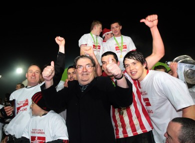 John Hume celebrating with the Derry City team after they won the League of Ireland First Division title in 2010.
