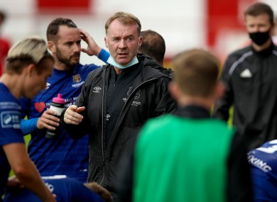 Waterford manager John Sheridan with his players at Tolka Park on Saturday.