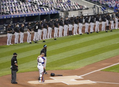 The players bow their heads on the field.