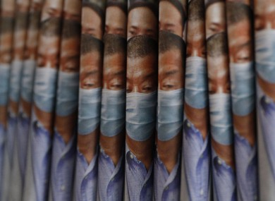 Copies of the Apple Daily newspaper, with front pages featuring Hong Kong media tycoon Jimmy Lai.