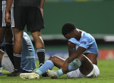 Manchester City's Raheem Sterling reacts at the end of the Champions League quarter-final against Lyon.
