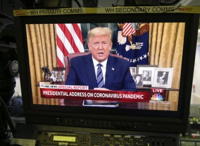 A TV monitor showing US President Donald Trump.