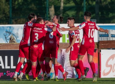 Sligo Rovers' players congratulate Alex Cooper after scoring a late winner against Waterford.