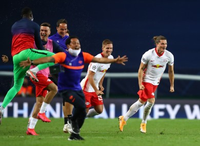 RB Leipzig players celebrate after their victory over Atletico Madrid.