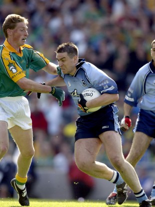 Trevor Giles tackles Johnny Magee during the 2002 Leinster semi-final.
