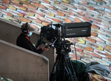 A TV camera operator wearing PPE during a Premier League match at Molineux.