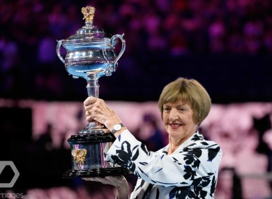 Margaret Court shows off a replica of the Daphne Akhurst trophy which is presented to the Australian Open Women's Singles winner.