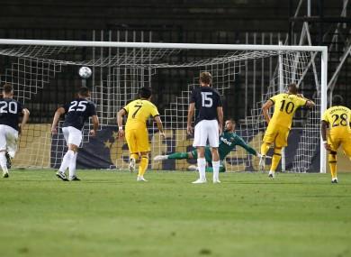 Tottenham's Harry Kane, centre right, scores a penalty.