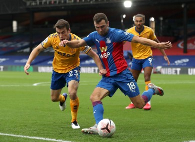 Seamus Coleman battles for possession with James McArthur.