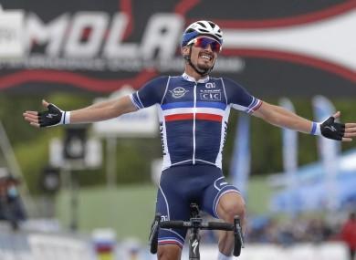 France's Julian Alaphilippe celebrates after winning the men's elite event.