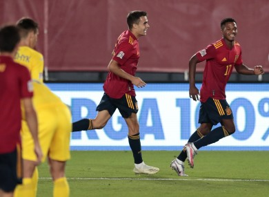 Spain's Ansu Fati, right, celebrates after scoring.