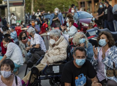 Residents of restricted mobility areas in Madrid gather yesterday during a protest to demand more resources for the public health system in the neighbourhood of Vallecas.