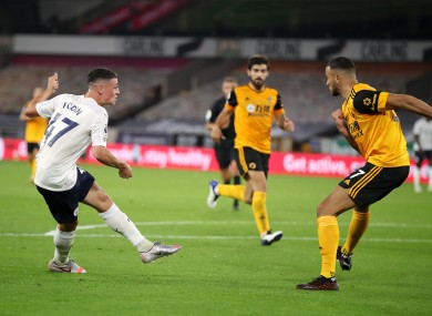 Manchester City's Phil Foden scores his goal during the game.