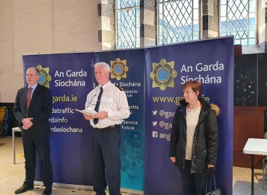 Kathleen Bergin (right) with gardaí this morning.