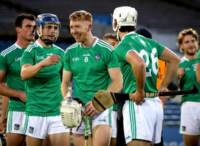 Cian Lynch and his Limerick team-mates celebrate after the game.