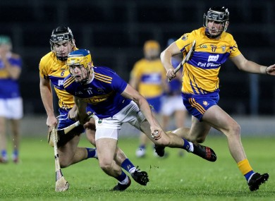 Conor Bowe in action for Tipperary with Clare's Dylan McMahon and Darragh Healy.