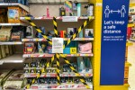 Items deemed non-essential taped off in a supermarket yesterday in Cardiff.