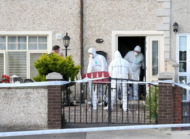 Pictured are garda forensics teams (technical bureau) removing the body from the scene in Croftwood Park in Ballyfermot, 27 July.