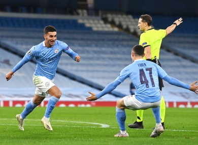 Ferran Torres celebrates with Phil Foden after scoring Manchester City's third goal against Porto.
