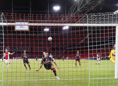 Fabinho clears the ball off the line for Liverpool.