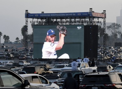 Fans at Dodger Stadium watch Clayton Kershaw pitch during Game One of the World Series.