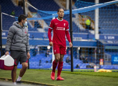 Virgil van Dijk limps off during the Merseyside derby.