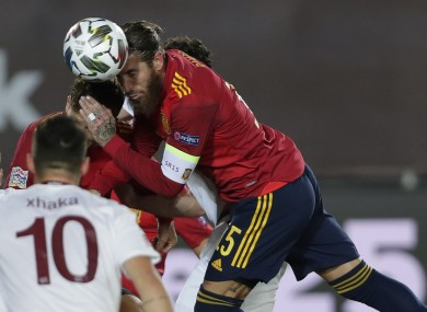 Spain's Sergio Ramos wins a header.