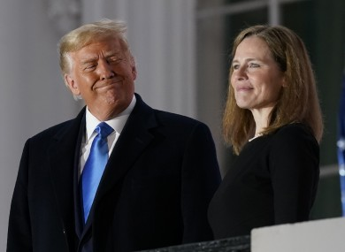 President Donald Trump and Amy Coney Barrett stand on the Blue Room Balcony last night
