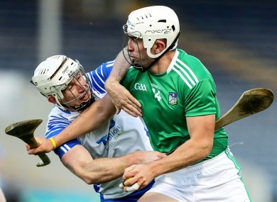 Waterford's Shane McNulty and Limerick's Aaron Gillane.