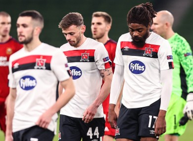 Dejection for Dundalk's Michael Duffy, Andy Boyle and Nathan Oduwa after the defeat to Rapid Vienna.