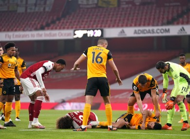 Luiz and Jimenez lay stricken on the turf following their collision.