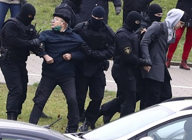 Belarusian riot police detain demonstrators during an opposition rally