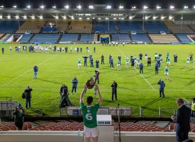 Declan Hannon raises the Munster senior hurling trophy.